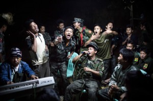 1st Prize Daily Life Single Julius Schrank, Germany, De Volkskrant 15 March 2013, Burma Kachin Independence Army fighters are drinking and celebrating at a funeral of one of their commanders who died the day before. The city is under siege by the Burmese army.
