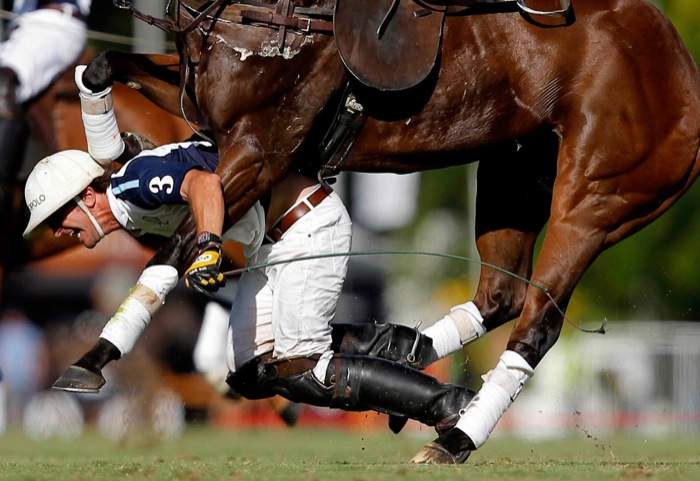 1st Prize Sports Action Singles Emiliano Lasalvia, Argentina for La Nación 01 December 2013 Pablo Mac Donough of Dolfina falls from his horse during the Argentine Polo Open in Buenos Aires, Argentina.