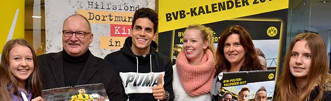 Autogramme für Dortmunder Kinder in Not: Marc Bartra und Raphael Guerreiro unterschreiben 462 Posterkalender