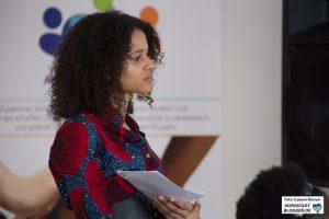Andrea Tarilayu Weber, Moderatorin der Podiumsdiskussion und Public Relations Officer von AfricanTide Union e.V.