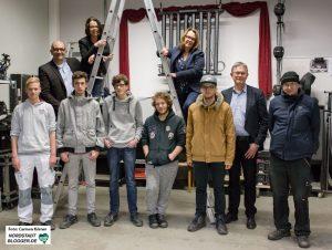 Die SPD-Landtagsabgeordneten zusammen mit Joachim Thiele, Geschäftsführer von dobeq und Teilnehmenden der Produktionsschule mit Lehrer.