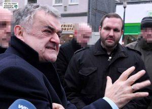 """Innenminister Herbert reut und der Vorsitzende der Neonazi-Partei """"Die Rechte"""", Sascha Krolzig, im Interview."""