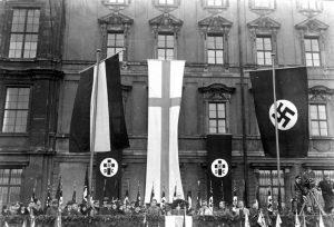 Die große Feier des Luthertages im Lustgarten in Berlin! Bischof Hossenfelder hält die Ansprache auf der Rampe des Berliner Schlosses im Lustgarten. 19.11.1933 Bundesarchiv, Bild 102-15234 / CC-BY-SA 3.0 [CC BY-SA 3.0