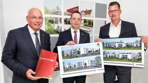 Klaus Graniki (Geschäftsführer), Andreas Laske (Prokurist Betriebswirtschaft) und Christian Nagel (Prokurist Wohnungswirtschaft) freuen sich über das erfolgreichste Geschäftsjahr der Unternehmensgeschichte.