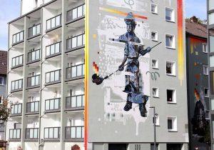 Motive zur Geschichte des Quartiers und von Hoesch - die ehemaligen Werkswohnungen sind das Herzstück des Vivawest-Bestands am Borsigplatz.
